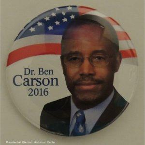 Dr. Ben Carson 2016. White campaign button face photo with flag