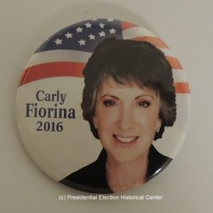 Carly Fiorina 2016. Red and white campaign button with US flag background