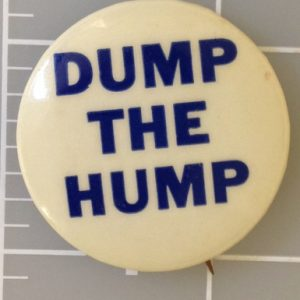 1.25 inch Dump the Hump white campaign button with blue lettering