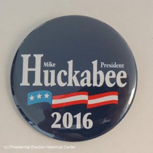 Mike Huckabee 2016 President blue campaign button with white lettering and flag banner