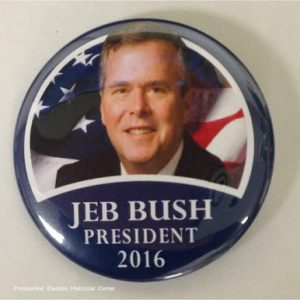 Jeb Bush for President 2016. Blue campaign button with flag behind face photo