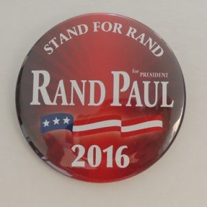 Rand Paul for President 2016 red campaign button with white lettering and flag banner