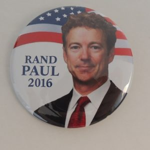 Rand Paul 2016 white campaign button face in front of American flag