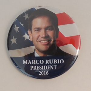 Marco Rubio President 2016 campaign button with front face view over American flag