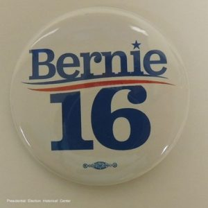 Bernie 16 white campaign button with blue lettering and union bug