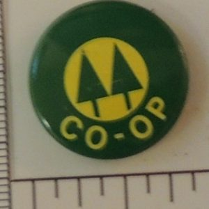 Co-Op special interest button yellow and green with tree symbol in center