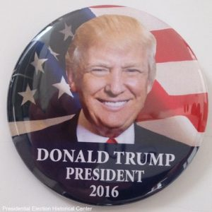 Donald Trump for President campaign button with flag in background