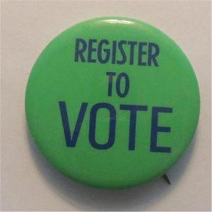 Register To Voteö green background blue lettering