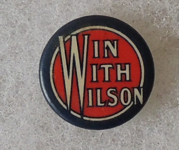 Original Win With Wilson Red, White, and Blue celluloid button with original back paper from the Whitehead and Hog Company