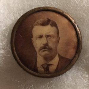 """5/8"""" Theodore Roosevelt face view Campaign Button with original back paper from The Harry Fisher Company"""